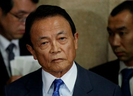 FILE PHOTO - Japan's Deputy Prime Minister and Finance Minister Taro Aso speaks to reporters in Tokyo