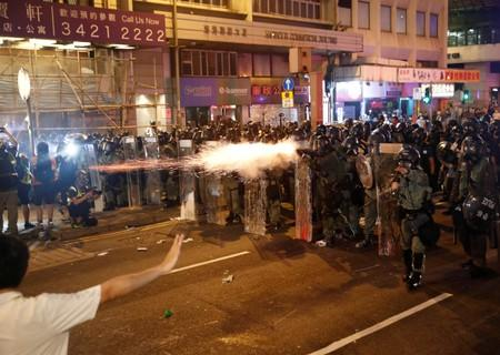 Riot police fire tear gas, after a march to call for democratic reforms in Hong Kong