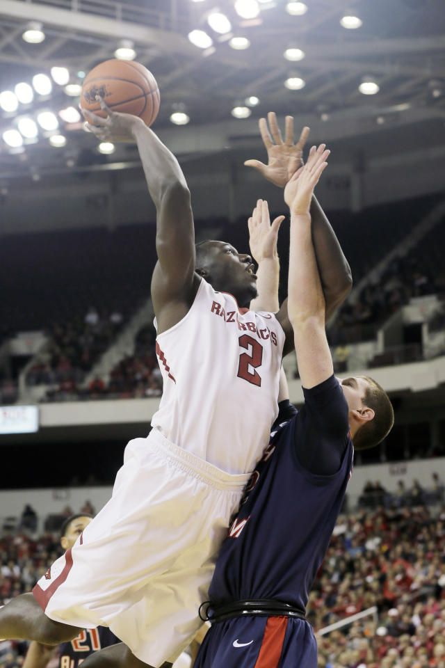 Arkansas' Alandise Harris (2) shoots over South Alabama's Austin Karazsia, right, in the first half of an NCAA college basketball game in North Little Rock, Ark., Saturday, Dec. 21, 2013. (AP Photo/Danny Johnston)