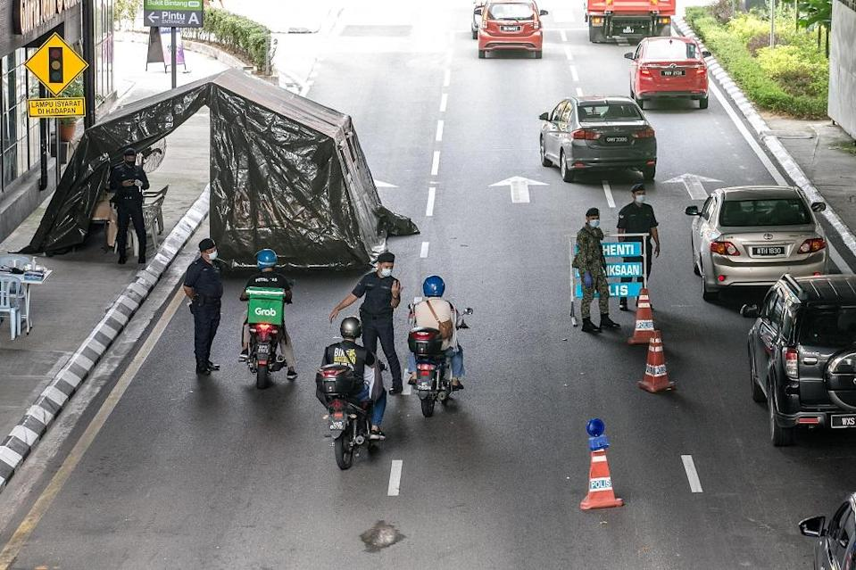 Soldiers and police officers conducting checks at a roadblock near Bukit Bintang in Kuala Lumpur January 13, 2021. — Picture by Firdaus Latif