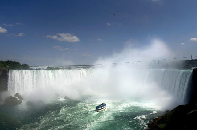 The Maid of the Mist enters near the dangers zone before Nik Wallenda's attempt to walk a 1,800-foot (550-meter) long tightrope over the brink of the Niagara Falls in Niagara Falls, Ont., on Friday, June 15, 2012. (AP Photo/The Canadian Press, Nathan Denette)