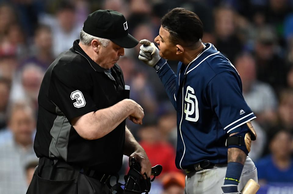 MLB home plate umpire Bill Welke (3) and San Diego Padres shortstop Manny Machado (13) have words following his ejection during the fifth inning against the Colorado Rockies at Coors Field. (Ron Chenoy-USA TODAY Sports)