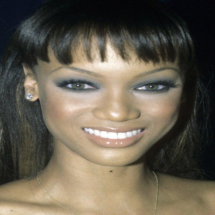 Photo of Tyra Banks in a nude dress and smoky makeup look