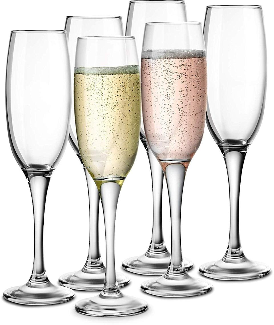 <p>Have some fun and celebrate with these <span>KooK Premium Clear Glass Champagne Flutes</span> ($25 for 6).</p>