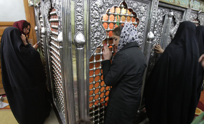 In this picture taken on Thursday, Feb. 16, 2012, a Jewish Iranian woman, center, prays along with Muslim women at the tomb of biblical prophet Daniel, in the city of Susa, some 450 miles ( 750 kilometers) southwest of the capital Tehran, Iran. All but lost amid the heated talk about a possible Israeli attack on Iran's suspect nuclear program are the thousands of Jews who live in the Islamic Republic and could be caught in the middle. (AP Photo/Vahid Salemi)