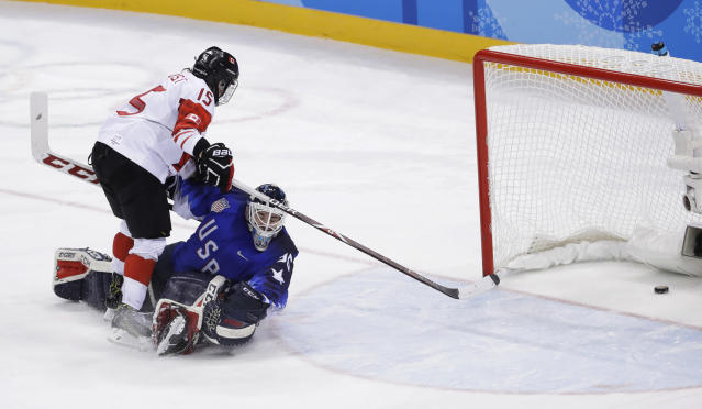 Melodie Daoust (15), of Canada, scores a goal past goalie Maddie Rooney (35), of the United States, in the penalty shootout during the women's gold medal hockey game at the 2018 Winter Olympics in Gangneung, South Korea, Thursday, Feb. 22, 2018.(AP Photo/Matt Slocum)