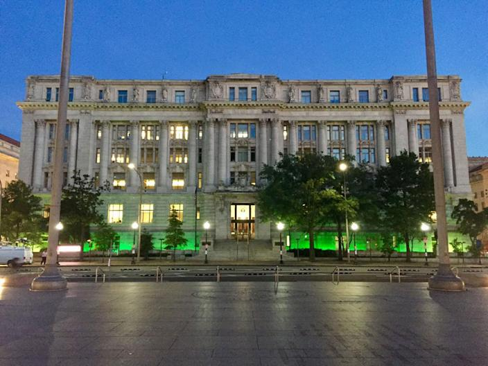 """<p>Photo posted by the Council of D.C. The council tweeted """"Exiting the Paris climate accord may make us see red & feel blue, but the Wilson Building's lit up green tonight to prove the fight endures."""" (Council of DC via Twitter) </p>"""