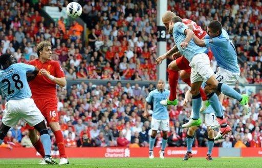 Liverpool's Martin Skrtel (2nd R) scores from a header