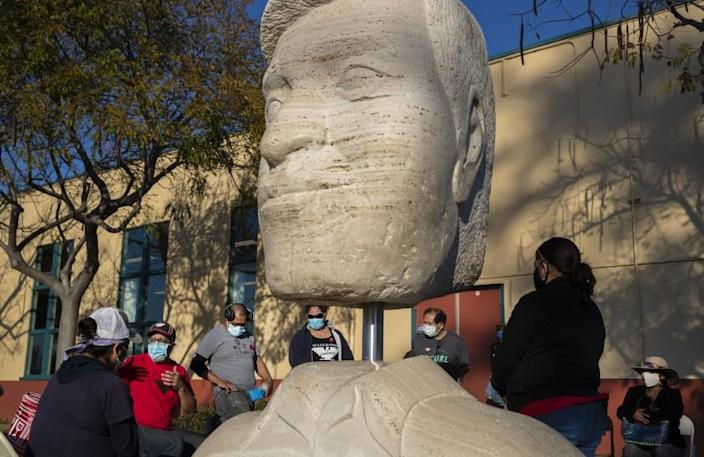 OXNARD, CA - FEBRUARY 10: Members of the United Farm Workers hold an organizing event near a sculpture of Cesar Chavez on Wednesday, Feb. 10, 2021 in Oxnard, CA. (Brian van der Brug / Los Angeles Times)