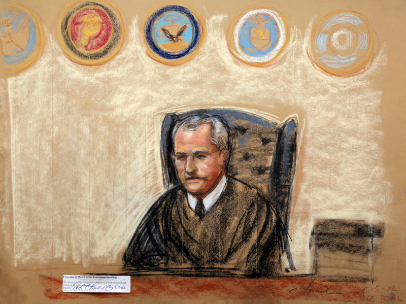 In this photo of a sketch by courtroom artist Janet Hamlin and reviewed by the U.S. Department of Defense, military judge U.S. Army Col. James Pohl presides the arraignment of the accused Sept. 11 attacks mastermind Khalid Sheikh Mohammed and four co-conspirators at the Guantanamo Bay U.S. Naval Base in Cuba, Saturday May 5, 2012. The self-proclaimed mastermind of the Sept. 11 attacks repeatedly declined to respond to a judge's questions Saturday and of his co-defendants, Walid bin Attash, was briefly restrained at a military hearing as five men charged with the worst terror attack in U.S. history appeared in public for the first time in more than three years. (AP Photo/Janet Hamlin, Pool)