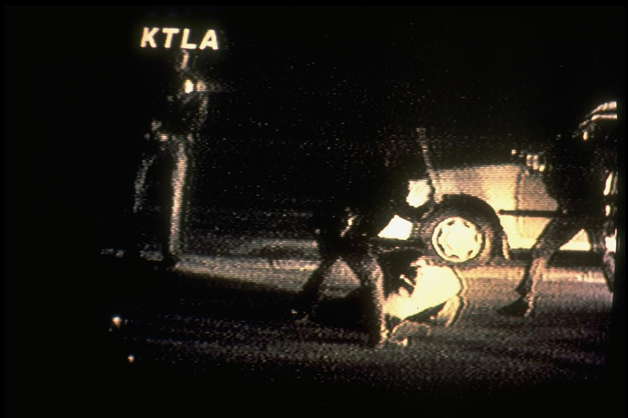 <p>An image from video shows Los Angeles Police officers beating motorist Rodney King as he lies on the ground; taken by camcorder enthusiast George Holliday fr. window overlooking street. (Photo by Charles Steiner/Image Works/Image Works/The LIFE Images Collection/Getty Images) </p>