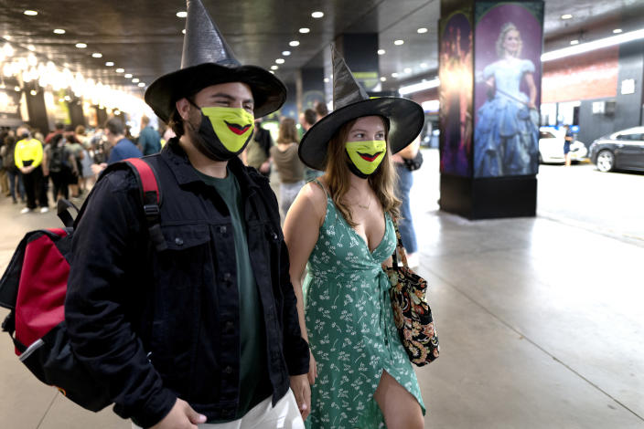 """Friends Adam Schaefer and Isabella Phillips of Philadelphia attend the opening of """"Wicked"""" at the Gershwin Theatre Tuesday, Sept. 14, 2021, in New York. The show opens after being closed due to Covid-19 concerns in early 2020. (AP Photo/Craig Ruttle)"""