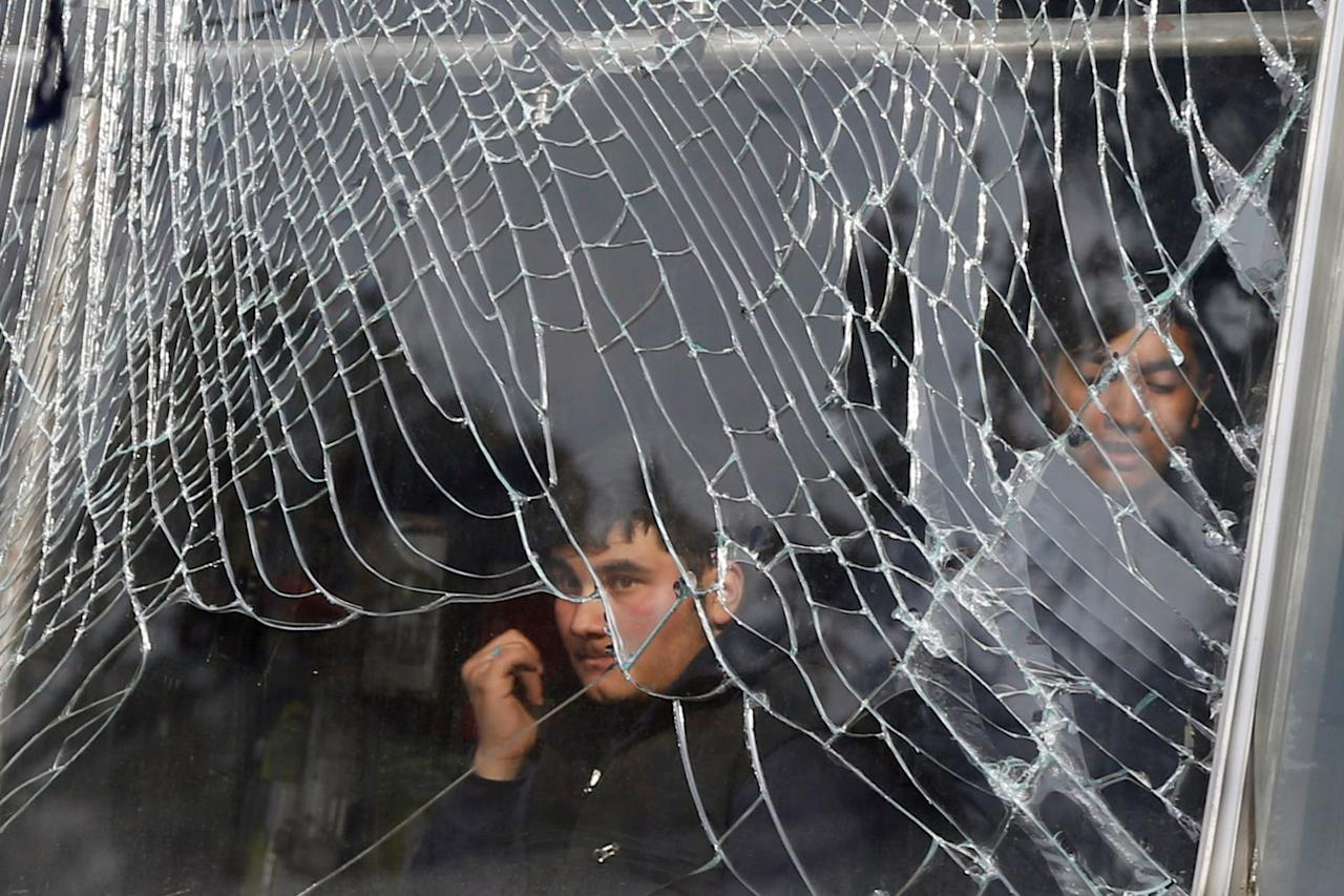 <p>A shopkeeper looks on behind broken glass of his shop, near the site of a car bomb attack in Kabul, Afghanistan, Jan. 27, 2018. (Photo: Omar Sobhani/Reuters) </p>