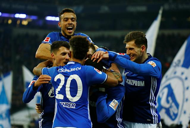 Soccer Football - Bundesliga - Schalke 04 vs TSG 1899 Hoffenheim - Veltins-Arena, Gelsenkirchen, Germany - February 17, 2018 Schalke's Breel Embolo celebrates with team mates after scoring but hise goal is subsequently disallowed REUTERS/Leon Kuegeler DFL RULES TO LIMIT THE ONLINE USAGE DURING MATCH TIME TO 15 PICTURES PER GAME. IMAGE SEQUENCES TO SIMULATE VIDEO IS NOT ALLOWED AT ANY TIME. FOR FURTHER QUERIES PLEASE CONTACT DFL DIRECTLY AT + 49 69 650050
