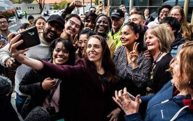 Ms Ardern was on the campaign trail with voters in Palmerston North - -/-