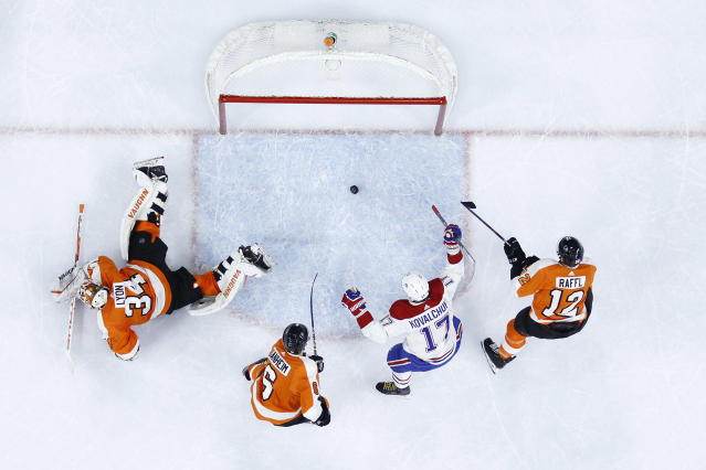 Montreal Canadiens' Ilya Kovalchuk (17) celebrates past Philadelphia Flyers' Alex Lyon (34), Philippe Myers (5) and Michael Raffl (12) after a goal by Tomas Tatar during the first period of an NHL hockey game, Thursday, Jan. 16, 2020, in Philadelphia. (AP Photo/Matt Slocum)