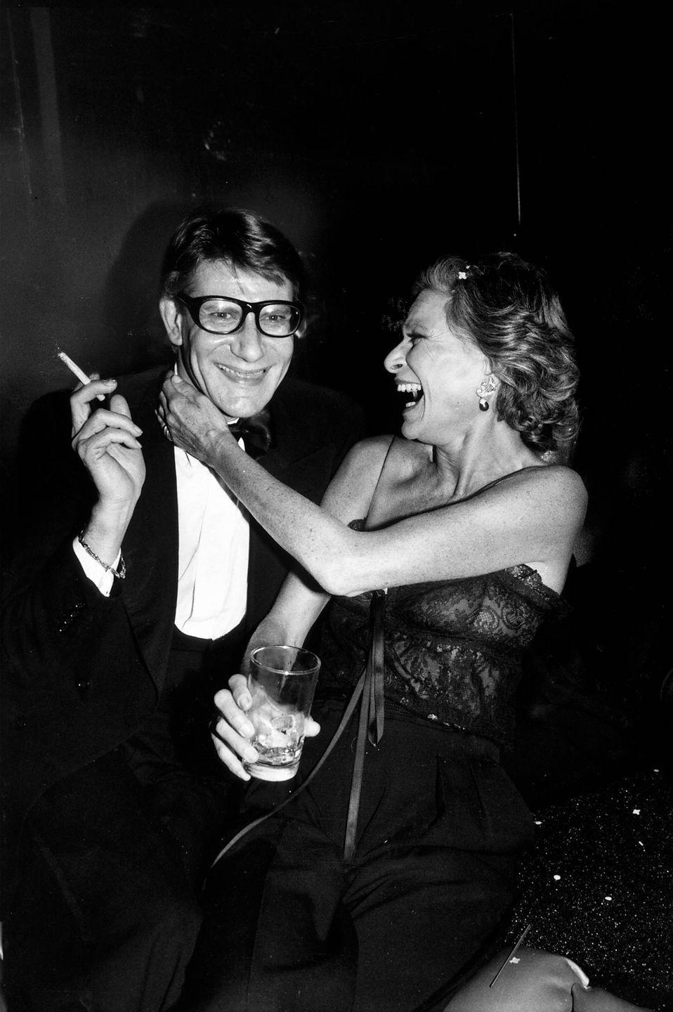 <p>Yves Saint Laurent with socialite Nan Kempner during a party for the launch of his new perfume called Opium, held aboard the sailboat Peking at the South Street Seaport Museum in New York in 1978.</p>