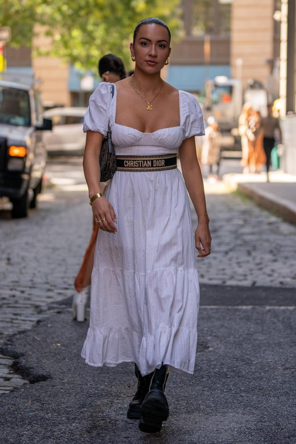 <p>Olivia Faria wearing a Dior belt and Ganni boots</p>