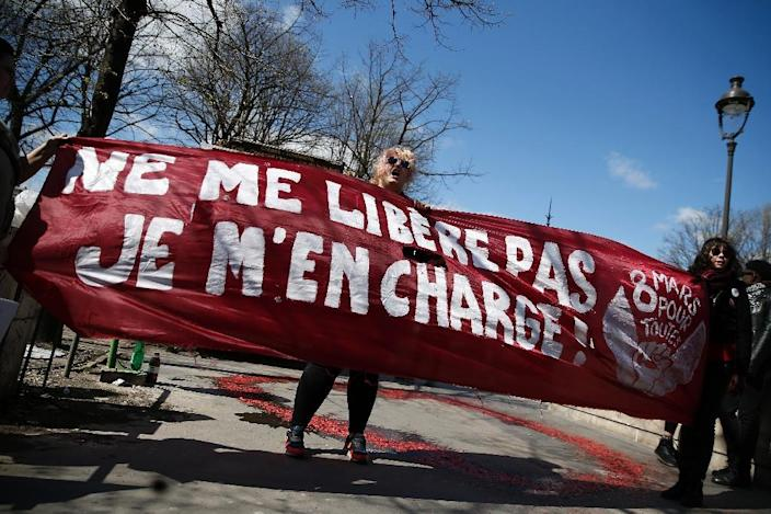 "Protesters hold a banner reading ""Don't liberate me, I'll take care of it myself!"" during a demonstration by sex workers and supporters near the French National Assembly in Paris on April 6, 2016 (AFP Photo/Thomas Samson)"