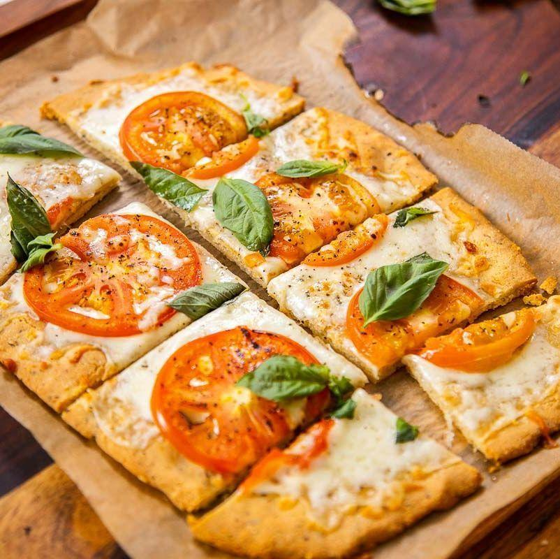 """<p><a href=""""https://www.delish.com/uk/cooking/recipes/a30686833/homemade-pizza-recipe/"""" rel=""""nofollow noopener"""" target=""""_blank"""" data-ylk=""""slk:Homemade pizza"""" class=""""link rapid-noclick-resp"""">Homemade pizza</a> is always more satisfying than delivery—even the low carb version! Consider your carb craving curbed. </p><p>Get the <a href=""""https://www.delish.com/uk/cooking/recipes/a30849173/almond-crust-pizza-recipe/"""" rel=""""nofollow noopener"""" target=""""_blank"""" data-ylk=""""slk:Almond Crust Pizza"""" class=""""link rapid-noclick-resp"""">Almond Crust Pizza</a> recipe.</p>"""