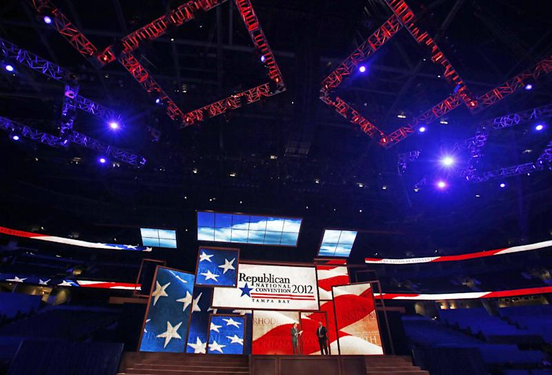 Republican National Committee Chairman Reince Priebus, left, and convention CEO William Harris unveil the stage and podium for the 2012 Republican National Convention, Monday, Aug. 20, 2012, at the Tampa Bay Times Forum in Tampa, Fla. (AP Photo/Scott Iskowitz)