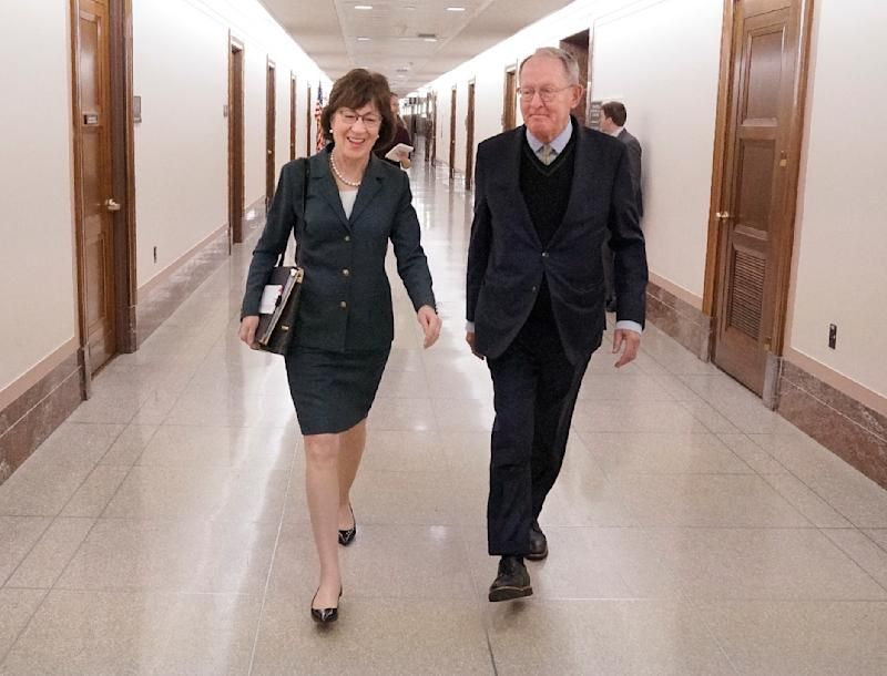 Sen. Susan Collins (R-Maine) walks with Sen. Lamar Alexander (R-Tenn.) after a hearing on Capitol Hill on Dec. 12, 2017.  (Staff Photo by Gregory Rec/Portland Press Herald via Getty Images)