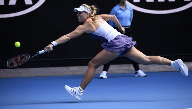 Germany's Angelique Kerber makes a backhand return to Australia's Priscilla Hon during their second round singles match at the Australian Open tennis championship in Melbourne, Australia, Thursday, Jan. 23, 2020. (AP Photo/Andy Brownbill)