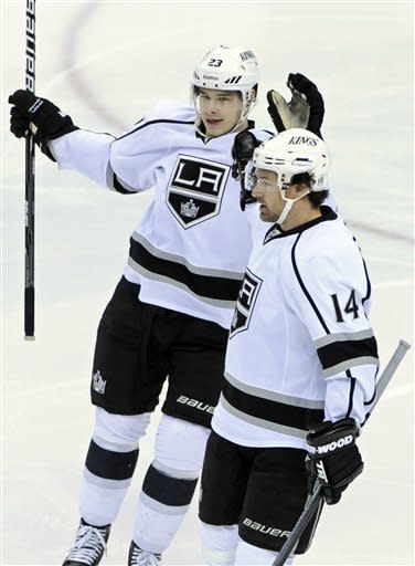 Los Angeles Kings' Dustin Brown, left, skates in to congratulate Justin Williams on Williams' goal in the first period of an NHL hockey game Tuesday, Feb. 28, 2012 in St. Paul, Minn. (AP Photo/Jim Mone)