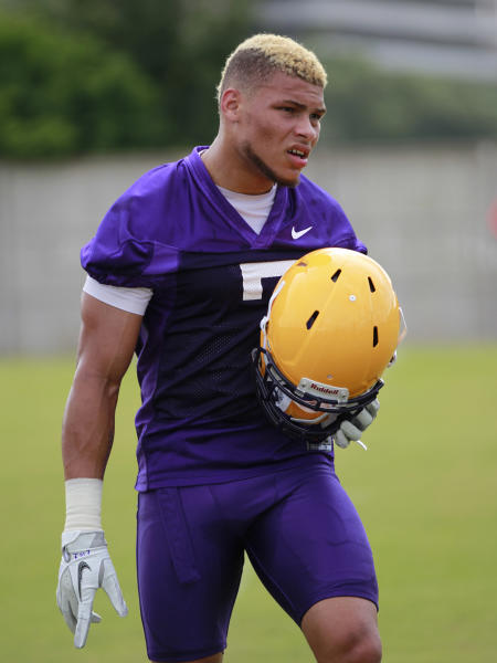 FILE - This Aug. 2, 2012 file photo shows LSU cornerback Tyrann Mathieu (7) during NCAA college football practice in Baton Rouge, La. LSU has dismissed Heisman Trophy finalist Mathieu from its football program for violating school and team rules. At a news conference Friday, Aug. 10, 2012, coach Les Miles would not specify the reason Mathieu was kicked off the team. (AP Photo/Gerald Herbert)