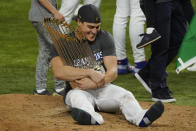 Los Angeles Dodgers second baseman Enrique Hernandez celebrates with trophy after defeating the Tampa Bay Rays 3-1 to win the baseball World Series in Game 6 Tuesday, Oct. 27, 2020, in Arlington, Texas. (AP Photo/Tony Gutierrez)