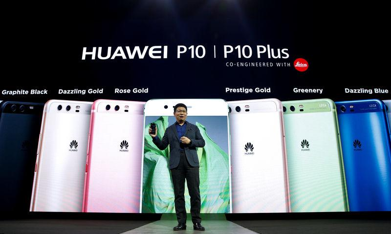 Yu, chief executive of Huawei's consumer business, holds up a new P10 device during the presentation ceremony at Mobile World Congress in Barcelona