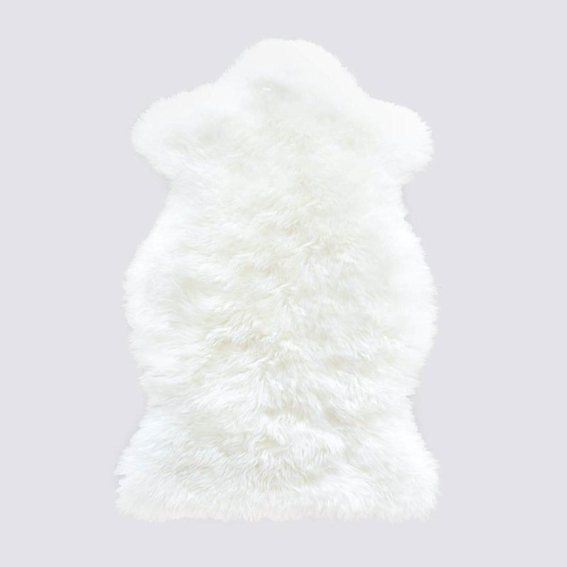 "This all natural, ethically sourced <a href=""https://www.the-citizenry.com/collections/best-sellers/products/sheepskin-throw"" target=""_blank"">Merino sheepskin throw</a> from Citizenry is an affordable but luxury gift."