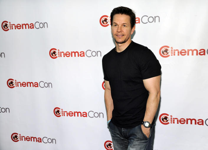 """Mark Wahlberg, a cast member in the upcoming film """"Transformers: Age of Extinction,"""" poses at the Opening Night Presentation from Paramount Pictures at CinemaCon 2014 on Monday, March 24, 2014, in Las Vegas. (Photo by Chris Pizzello/Invision/AP)"""