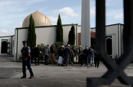 FILE PHOTO: A policeman stands guard as members of the Muslim community visit Al-Noor mosque after it was reopened in Christchurch