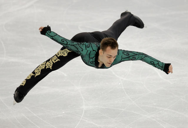 Paul Bonifacio Parkinson of Italy competes in the men's short program figure skating competition at the Iceberg Skating Palace during the 2014 Winter Olympics, Thursday, Feb. 13, 2014, in Sochi, Russia. (AP Photo/Vadim Ghirda)
