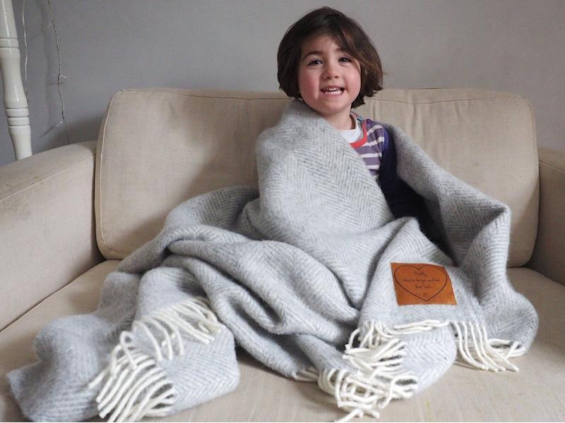 """<a href=""""https://fave.co/2DMXwPM"""">Woollen Throw Personalised with a Message Engraved on Leather Patch, Stabo, Etsy,</a> &pound;84 (Photo: Huffington Post UK )"""