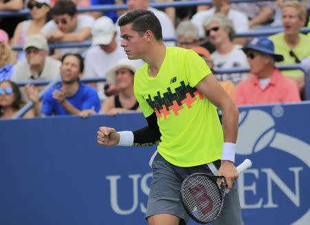 Milos Raonic of Canada reacts after defeating Victor Estrella Burgos of the Dominican Republic during their match at the 2014 U.S. Open tennis tournament in New York