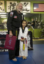 Willie Nelson, the country music icon who turns 81 this week, poses with Reese Park, 5, one of the youngest pupils of Sam Um, as he receives his fifth-degree black belt in the martial art of Gong Kwon Yu Sul on Monday, April 28, 2014, in Austin, Texas. (AP Photo/Austin American-Statesman, Ralph Barrera) AUSTIN CHRONICLE OUT, COMMUNITY IMPACT OUT, INTERNET AND TV MUST CREDIT PHOTOGRAPHER AND STATESMAN.COM, MAGS OUT