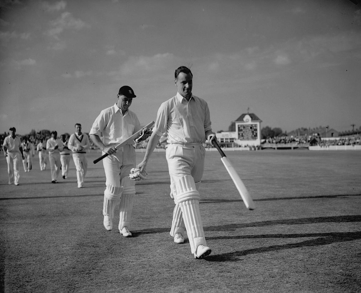 June 1957:  English cricketers Peter May (1929 - 1984) and Colin Cowdrey (1932 - 2000) (left) leaving the field at Edgbaston, Birmingham, after a record partnership of 411 runs against the West Indies.  (Photo by Central Press/Getty Images)