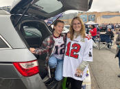 Sisters Devon Poduje, 20, right, and Tiegan Poduje, 13, of West Hartford, Connecticut, sport Tom Brady jerseys, with Devon wearing a Tampa Bay Buccaneers version and Tiegan wearing a New England Patriots version before an NFL football game between the two teams, Sunday, Oct. 3, 2021, at Gillette Stadium in Foxborough, Mass. (AP Photo/Barry Wilner)