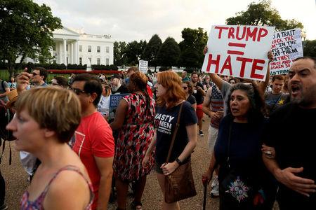 """FILE PHOTO: People gather for a vigil in response to the death of a counter-demonstrator at the """"Unite the Right"""" rally in Charlottesville, outside the White House in Washington, DC, U.S. on August 13, 2017.  REUTERS/Jonathan Ernst/File Photo"""