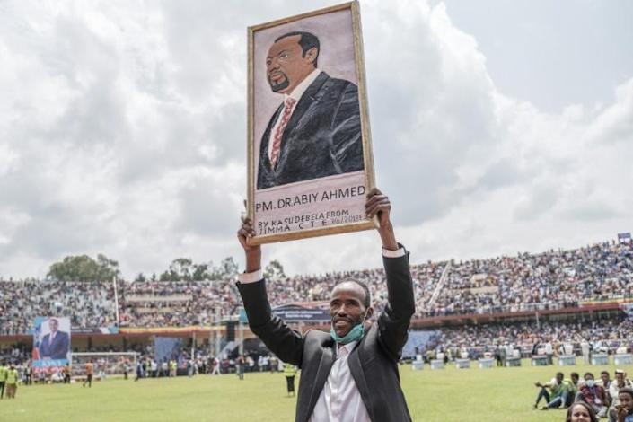 Supporter: An Abiy fan holds a portrait of his hero