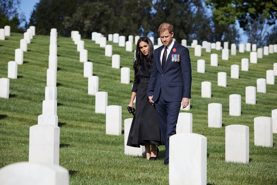 Prince Harry and Meghan Markle laying flowers at Los Angeles National Cemetery