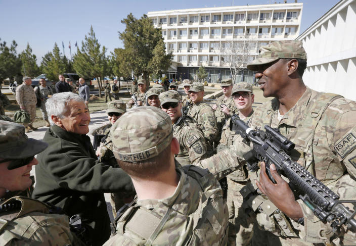 U.S. Secretary of Defense Chuck Hagel, left, is greeted by members of the U.S. Army and Marines during his visit to the Kabul Military Training Center in Kabul, Afghanistan, Sunday, March 10, 2013. Hagel is on his first trip to Afghanistan as defense secretary. (AP Photo/Jason Reed, Pool)