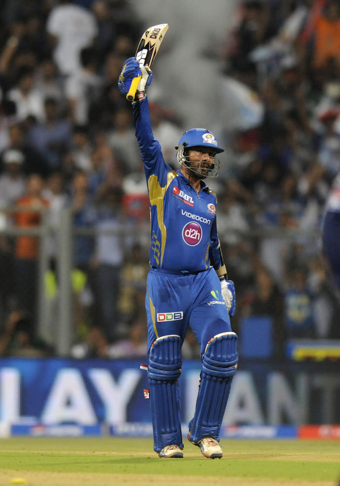 Dinesh Karthik of Mumbai Indians celebrates after scoring a half century during match 10 of the Pepsi Indian Premier League ( IPL) 2013  between The Mumbai Indians and the Delhi Daredevils held at the Wankhede Stadium in Mumbai on 9th April 2013 ..Photo by Pal Pillai-IPL-SPORTZPICS ..Use of this image is subject to the terms and conditions as outlined by the BCCI. These terms can be found by following this link:..https://ec.yimg.com/ec?url=http%3a%2f%2fwww.sportzpics.co.za%2fimage%2fI0000SoRagM2cIEc&t=1506437857&sig=wfpvYYnqIB2j2s4M0cHOWw--~D