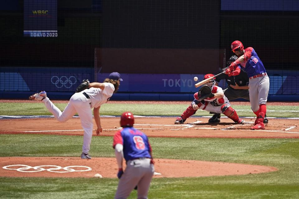 Scott Kazmir pitches the baseball to Julio Rodriguez at the Tokyo Olympics.