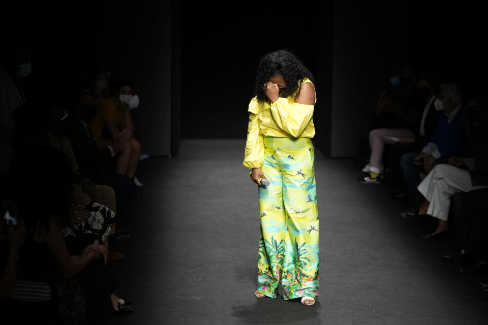 Designer Joy Meribe is overcome by emotion at the end of her Spring Summer 2022 collection, unveiled during the Milan Fashion Week, in Milan, Italy, Wednesday, Sept. 22, 2021. (AP Photo/Luca Bruno)