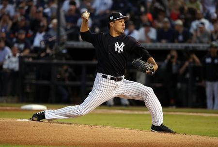 Mar 8, 2019; Tampa, FL, USA; New York Yankees starting pitcher Masahiro Tanaka (19) throws a pitch during the first inning against the Detroit Tigers at George M. Steinbrenner Field. Mandatory Credit: Kim Klement-USA TODAY Sports