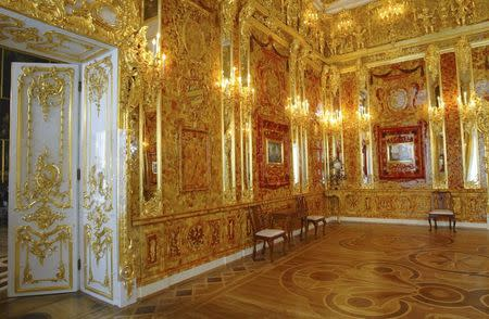 File photo of the the Amber Room just before its opening after a complete  reconstruction in the Catherine Palace in St. Petersburg May 31, 2003.   REUTERS/Alexander Zemlianchenko