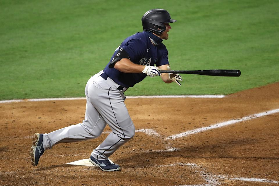 ANAHEIM, CALIFORNIA - JULY 29:  Kyle Seager #15 of the Seattle Mariners runs to first after hitting an RBI single during the sixth inning of a game against the Los Angeles Angels at Angel Stadium of Anaheim on July 29, 2020 in Anaheim, California. (Photo by Sean M. Haffey/Getty Images)